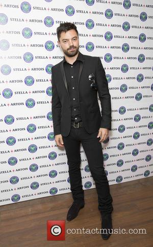Actor Dominic Cooper seen posing alone and with David Haye & Luke Pasqualino at the launch of The Time Portal...