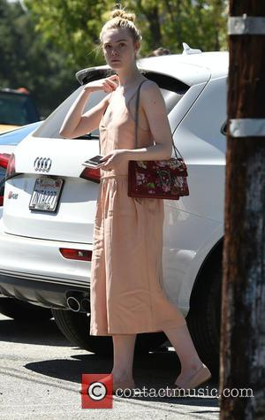 Elle Fanning, who is currently starring in the new film The Neon Demon, is seen out in L.A shopping whilst...