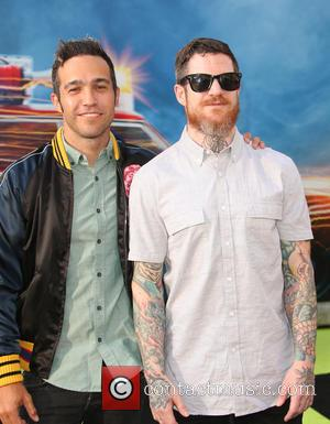 Pete Wentz seen posing alone and with Andy Hurley of Fall Out Boy at the Los Angeles premiere of 'Ghostbusters'...