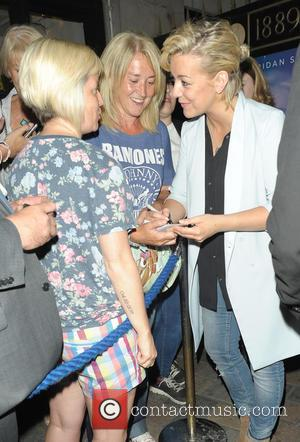Sheridan Smith is full of smiles as she poses for pictures with fans outside The Savoy Theatre after performing in...
