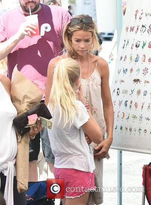 Denise Richards takes her gorgeous daughters, Lola Rose Sheen and Eloise Joni Richards, to the Farmers Market to do some...