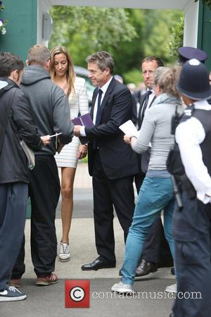 Actor Hugh Grant seen entering The All England Lawn Tennis Club at Wimbledon for the 2016 Men's Final. London, United...