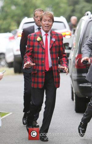 Singer Cliff Richard seen entering The All England Lawn Tennis Club at Wimbledon whist wearing a bright tartan jacket. Cliff...