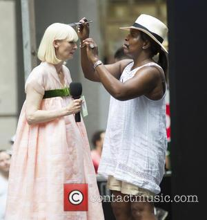 Tilda Swinton seen on Wall Street wearing a long light coloured dress whilst filming a scene for the new movie...