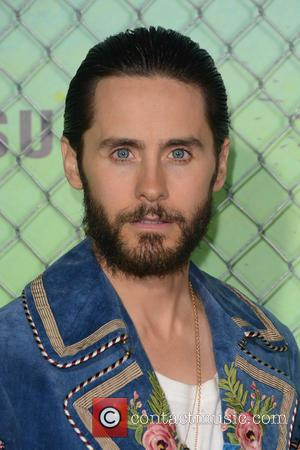 Jared Leto seen wearing a blue embroidered three-quarter length jacket at the 'Suicide Squad' World Premiere helf at the Beacon...