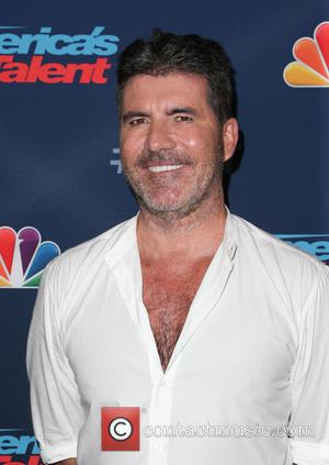 Simon Cowell Cutting Back On Cigarettes And Alcohol