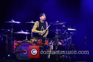 Travis Barker performing with his band Blink-182 at the Perfect Vodka Amphitheatre - West Palm Beach, Florida, United States -...