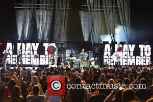 Kevin Skaff, Jeremy McKinnon, Joshua Woodward, Alex Shelnutt and Neil Westfall of A Day To Remember perform live at the...