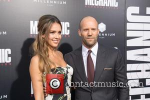 Jessica Alba posing alone and with her co-star Jason Statham at the premiere of Summit Entertainment's 'Mechanic 2: Resurrection' at...