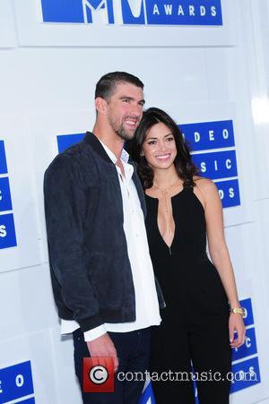 Michael Phelps , Nicole Johnson - Michael Phelps and his fiancee Nicole Johnson attending the MTV Video Music Awards 2016...