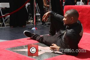 Usher seen with various friends and colleagues, including Stevie Wonder, at his Star ceremony. The musician and actor is the...