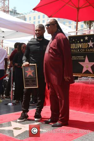 Usher Raymond and Stevie Wonder