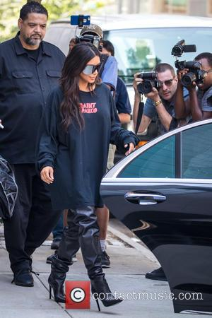 Kim Kardashian 'Badly Shaken' After Being Held At Gunpoint In Hotel Room