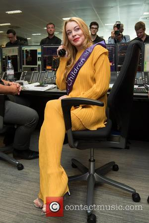 Lindsay Lohan Makes Red Carpet Comeback After Seven-month Hiatus