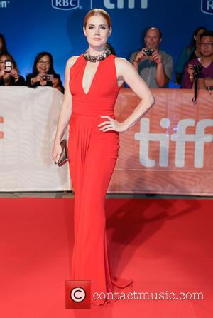 Amy Adams poses alone and with co-stars including Jeremy Renner. Seen at the premiere of 'Arrival' at the 41st annual...