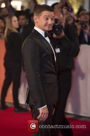 Jeremy Renner poses alone and with co-star Amy Adams at the premiere for 'Arrival' held as part of the annual...