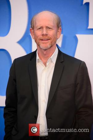 Ron Howard poses alone and with producer Brian Grazer at the world premiere of 'The Beatles: Eight Days A Week...