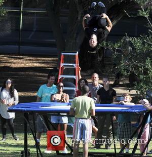 Adam Sandler gives his wife Jackie Sandler a high five after nailing her scene on a trampoline for his new...