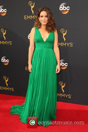 Tina Fey seen on the red carpet at the 68th Annual Primetime Emmy Awards held at the Microsoft Theater Los...
