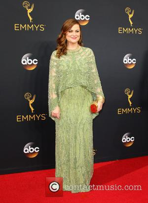 Amy Poehler seen on the red carpet at the 68th Annual Primetime Emmy Awards held at the Microsoft Theater Los...