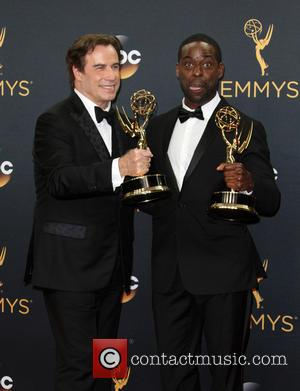 John Travolta and Sterling K. Brown