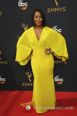 Angela Bassett and Courtney B. Vance seen on the red carpet at the 68th Annual Primetime Emmy Awards held at...