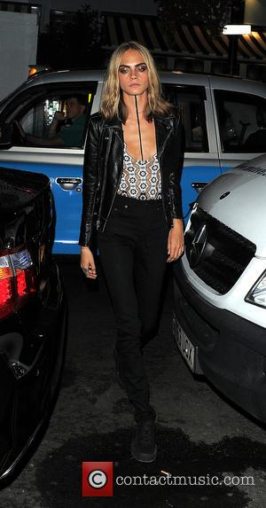 Cara Delevingne arrives at Soho House for a dinner party after the Burberry Prorsum show - London, United Kingdom -...