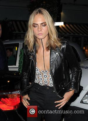 Cara Delevingne Debuts Eye-catching Neck Tattoo