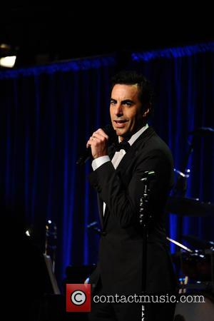 Sacha Baron Cohen talks to the audience at the Friars Club Gala who honoured the Icon Award to Martin Scorsese...