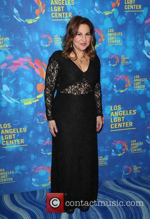 Kathy Najimy posing alone and with Mo Gaffney at the Los Angeles LGBT Center's 47th Anniversary Gala Vanguard Awards held...