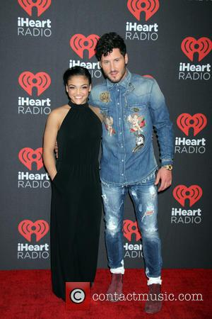 Val Chmerkovskiy posing alone and with Laurie Hernandez before entering the iHeartRadio Music Festival held at T-Mobile Arena in Las...