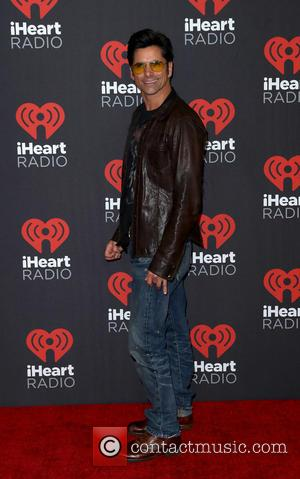 John Stamos seen entering the iHeartRadio Music Festival held at T-Mobile Arena Las Vegas, Nevada, United States - Saturday 24th...