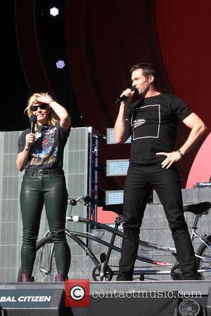 Chelsea Handler on stage alone and with Hugh Jackman at the 2016 Global Citizen Festival held in Central Park, New...