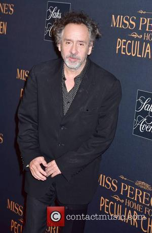 Tim Burton and Jane Goldman attending the New York premiere of 'Miss Peregrine's Home for Peculiar Children' held at Saks...