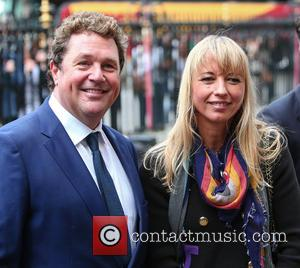 Michael Ball and Sara Cox arrive at the Service of Thanksgiving for Sir Terry Wogan. Friends, Family and colleagues gather...