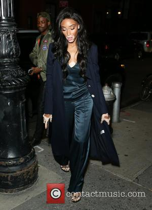 Winnie Harlow posing alone and with Huggle App founders Stina Sanders and Valerie Stark who were hosting an evening to...