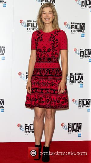 Rosamund Pike attends the LFF Opening Night Gala photocall for her new film 'A United Kingdom' held at the May...