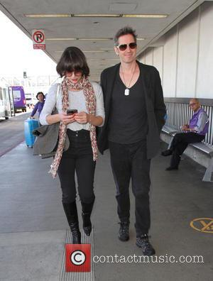 Milla Jovovich and husband Paul W.S. Anderson depart from the airport - Los Angeles, California, United States - Thursday 6th...