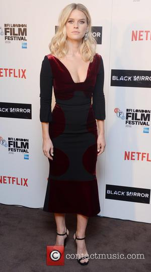 Alice Eve poses alone and with Bryce Dallas Howard at the BFI London Film Festival Photocall for 'Black Mirror'. London,...