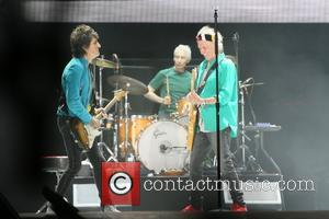 Ronnie Wood and Keith Richards with the rest of The Rolling Stones seen performing at Desert Trip festival held at...
