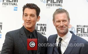 Aaron Eckhart and Miles Teller