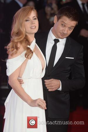 Jeremy Renner and Amy Adams