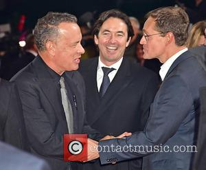 Tom Hanks seen stopping for photos alone and with Rita Wilson at the German Premiere of 'Inferno' held at Cinestar...