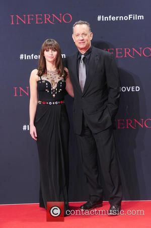 Felicity Jones seen alone and with Tom Hanks at the German Premiere of 'Inferno' held at Cinestar Sony Center at...