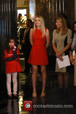 Dakota Fanning Lights The Empire State Building In Honor Of International Day Of The Girl - New York, United States...