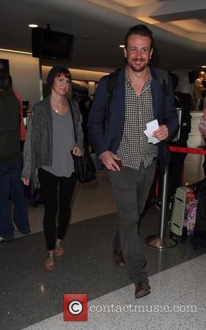 Jason Segel departs from the airport with his girlfriend photographer Alexis Mixter - Los Angeles, California, United States - Thursday...