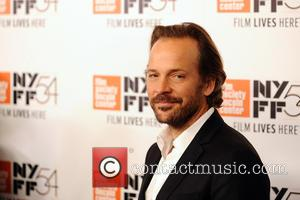 Peter Sarsgaard poses alone and with Natalie Portman and Noah Oppenheim at the 54th New York Film Festival screening of...