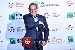 Oliver Stone attends a photocall during the 11th Rome Film Festival at the Auditorium Parco della Musica - Rome, Italy...