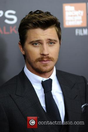 Garrett Hedlund stops for photos on the red carpet at the 54th New York Film Festival premiere of 'Billy Lynn's...