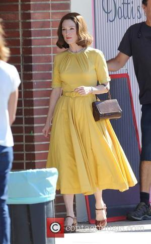 Julianne Moore seen wearing yellow 50's attire on the set of 'Suburbicon'. The film has been written by the Coen...